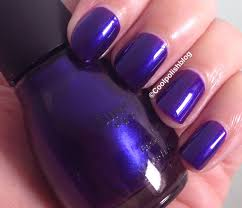 no filter this polish is a deep purple with a strong blue shimmer