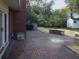 brick paver patio with seat walls in arlington heights landscaping