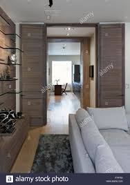 view through double doors to hallway in chelsea apartment london