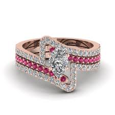 have a look at our pear shaped trio wedding ring sets