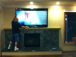 hang tv over stone fireplace brick fireplaces ation install above