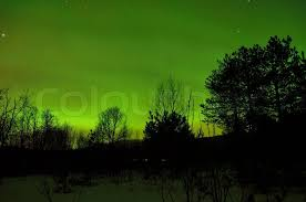 strong borealis covers the sky in a bright green
