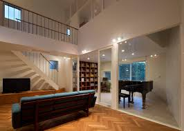two story living room arch wall house naf architect two story living room inhabitat