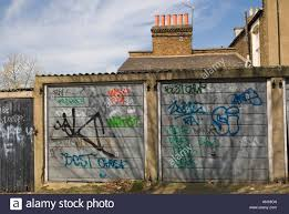 Covered Garage by Graffiti Covered Garage Doors In South London Stock Photo Royalty