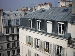 exterior mansard roof victorian architecture with wooden windows
