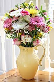 pitcher of fresh cut flowers pictures photos and images for