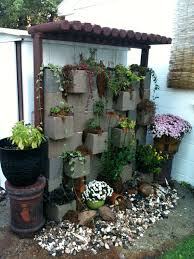 cinder block arbor good idea to hide an old shed backyard