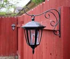 must do dollar store solar lights on plant hook for backyard