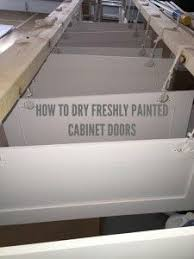 Spray Painting Kitchen Cabinet Doors How To Spray And Let Dry Freshly Painted Kitchen Cabinet Door No