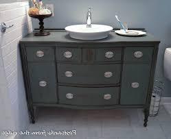 dresser made into bathroom vanity of featuring rectangular