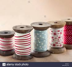 ribbon spools wooden ribbon spools for christmas present wrapping on brown