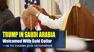 trump welcomed in saudi arabia with gold collar as his troubles