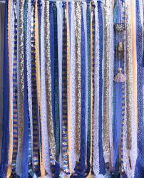 navy blue white lace ribbon sparkly fabric wedding ceremony