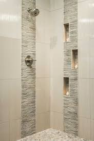 bathroom shower tile design spruce up your shower by adding pebble tile accents click the pin