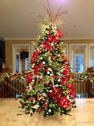 white christmas tree with red and gold decorations white christmas