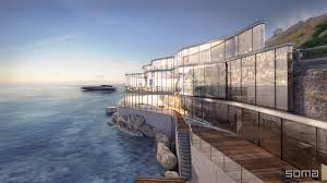 amazing glass home on the edge of sea and rock