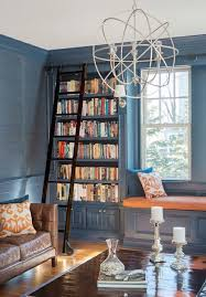 eclectic library with crown molding u0026 window seat zillow digs