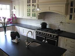 granite countertop belwith cabinet pulls tiling a kitchen wall