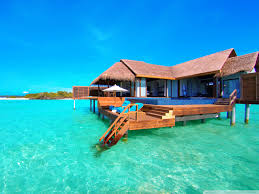 water bungalows on a tropical island hd desktop wallpaper