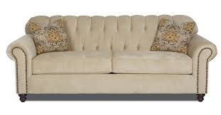 traditional stationary sofa with rolled arms and nailhead trim by