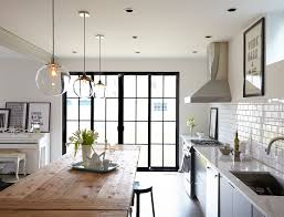 good looking farmhouse kitchen lighting with wooden table