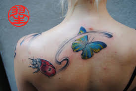 calligraphy butterfly ladybug tattoo back habu san philip