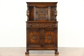 english tudor style 1920 antique carved oak bar or china cabinet