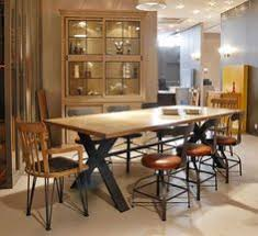 recovery dining table yoyo design the colorado dining table is a unique and contemporary design that