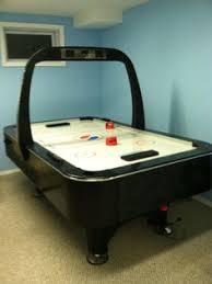 Arctic Wind Air Hockey Table by The Avenger Air Hockey Table Features A Sleek Modern Design This