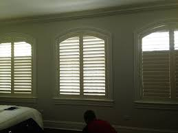 arch top shutters from norman shutters designed by curtain couture