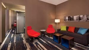 Living Room Vs Parlor Room Types Aloft Detroit At The David Whitney