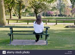 sitting alone on park bench stock photo royalty free image
