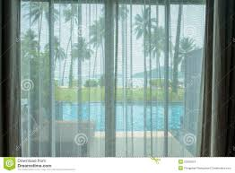 curtains with beach view stock photo image 52052613