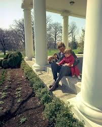 president john f kennedy plays with jfk jr outside oval office