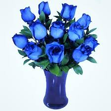 blue roses delivery a dozen blue roses in a blue vase by flowers story london florists