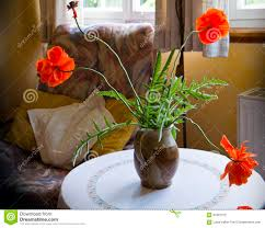 Vase With Red Poppies Still Life Red Poppy Flowers In Vase On Round Table Stock Photo