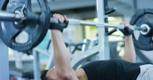 Bodybuilder Bench Press Bodybuilder In The Gym Works With A Barbell Bench Press