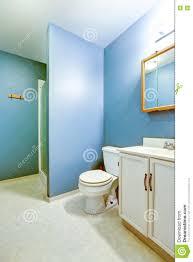 blue interior of old style bathroom with linoleum flooring stock