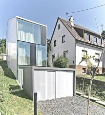 narrow hillside home plans ideas picture tall minimalistic hillside house built from concrete below thumb xauto plans sloping lot