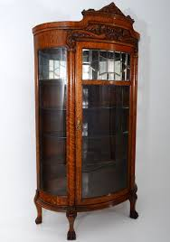 american oak china cabinet with leaded glass door and curved side