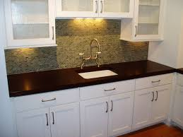all white kitchen cabinets and sink mosaic backsplash tile dark