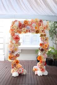 wedding backdrop arch wedding flower arch in white orange and pink colors bouquets