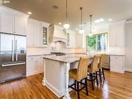 Hardwood Floors With White Cabinets Traditional Kitchen With Glass Panel U0026 Complex Granite Counters In