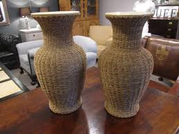 Large Ceramic Vases A Large Pair Of Rattan Wrapped Ceramic Vases In Objects Art And Curios