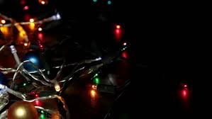 closeup of a tree with decorations and lights stock