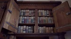 Castle Bookshelf Books Put In Row In Bookshelf In Old Cupboard Stock Video Footage