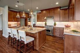 white kitchen countertops with brown cabinets sheri putzke what s brewing in real estate brown kitchen
