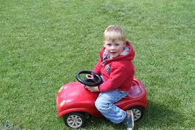 toddler toy car free images grass lawn play boy red child product toddler