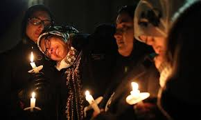 university lighting chapel hill thousands gather for slain muslim students in chapel hill world