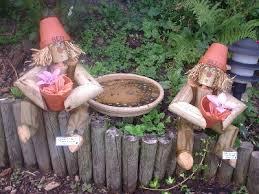 wooden flower potman gnomes garden ornament shop woodenmen co uk